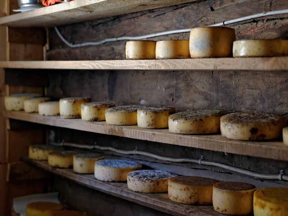 round cheeses on rack