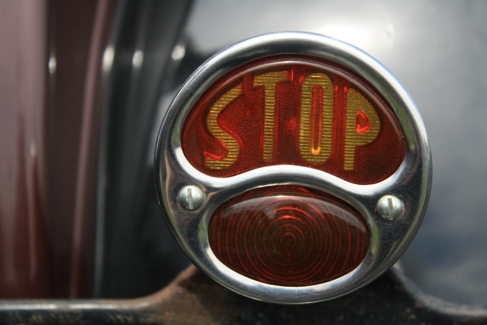 close-up photography of stop button