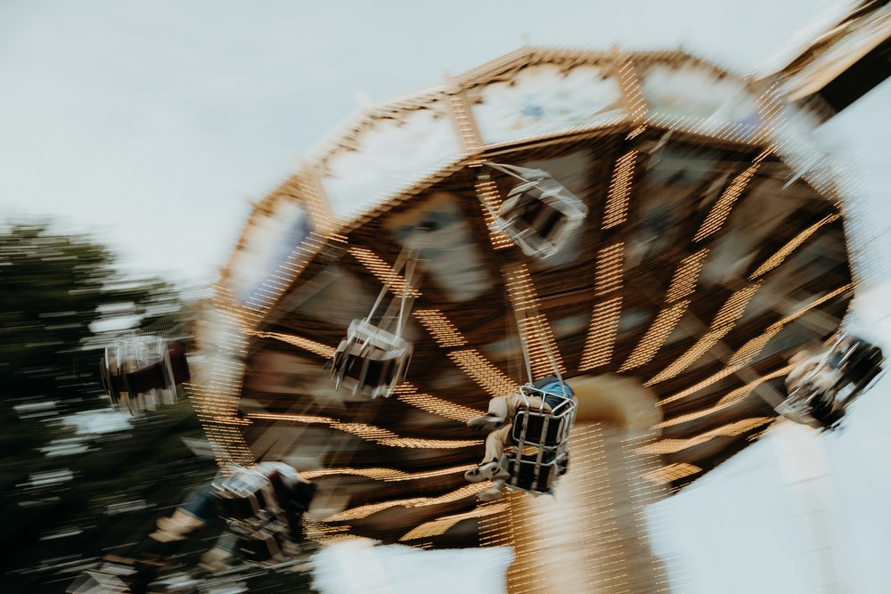 low angel photo of spinning ride