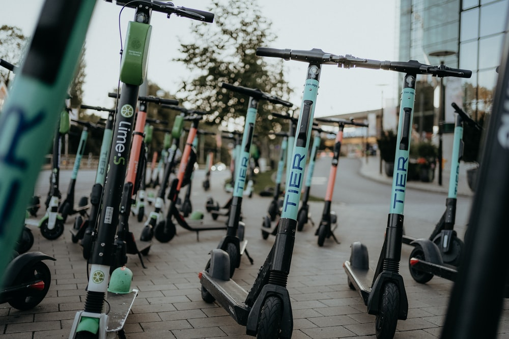electric scooters parked on sidewalk