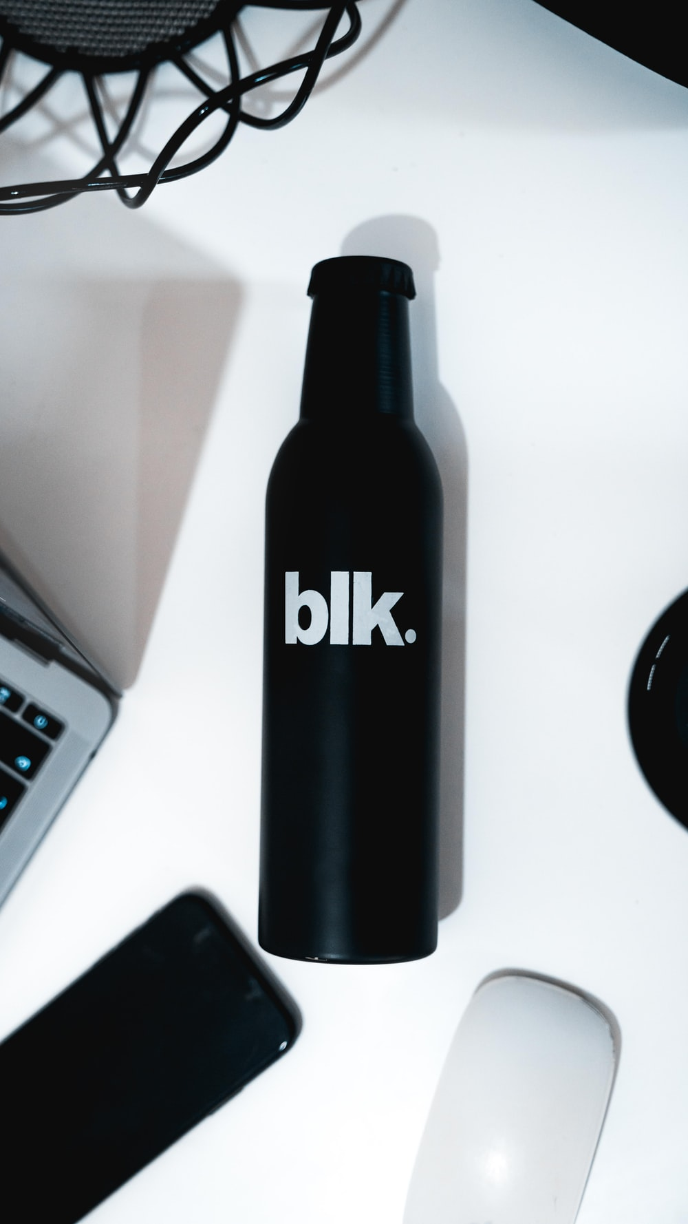 black and white labeled bottle close-up photography