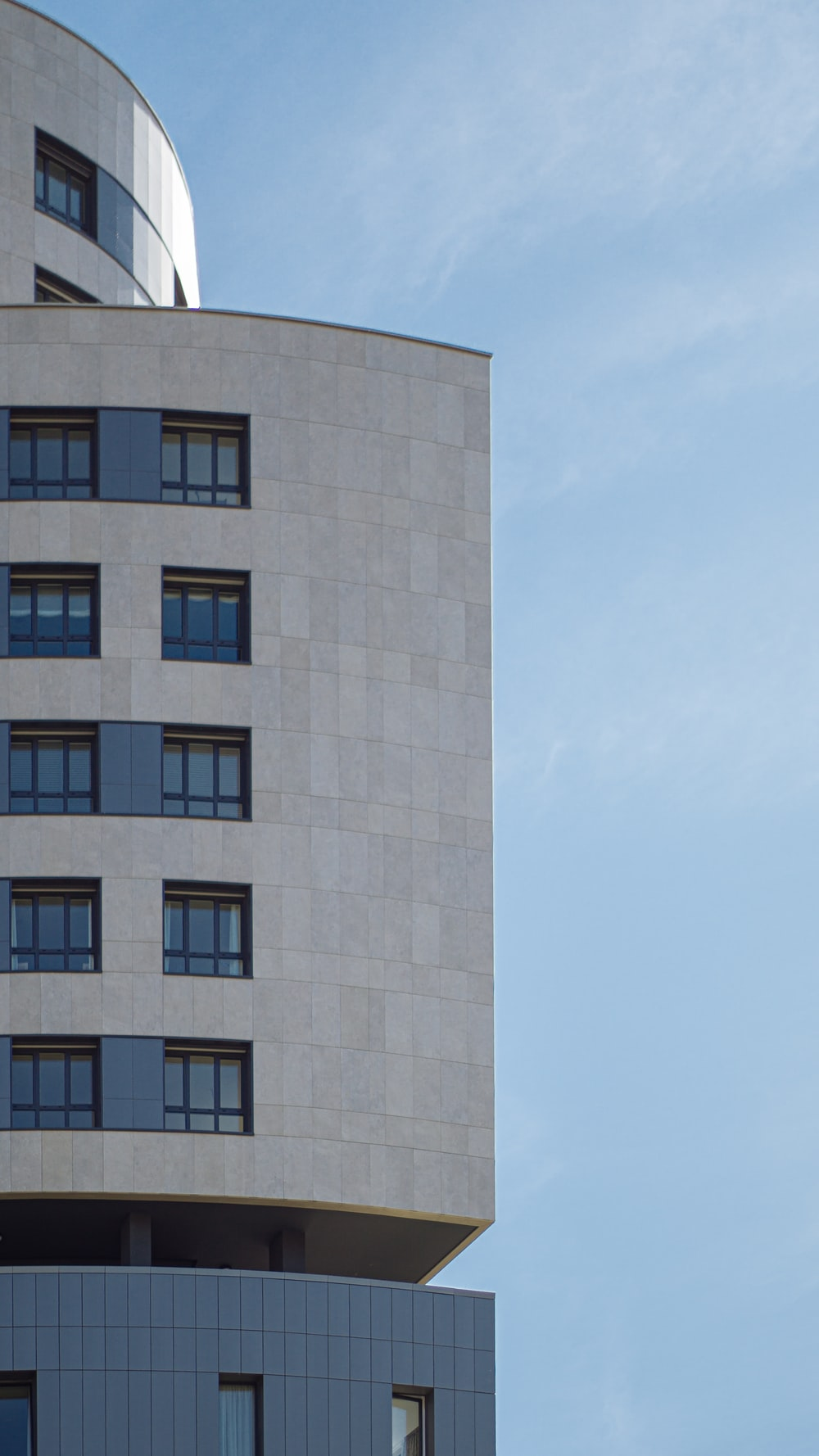 white and blue concrete building at daytime close-up photography