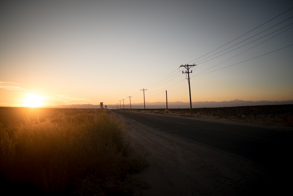 silhouette photo of gray pavement road