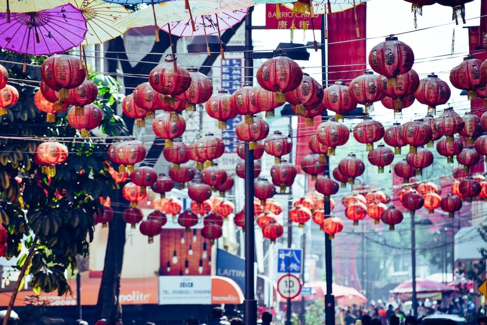red paper lanterns hanging on rope