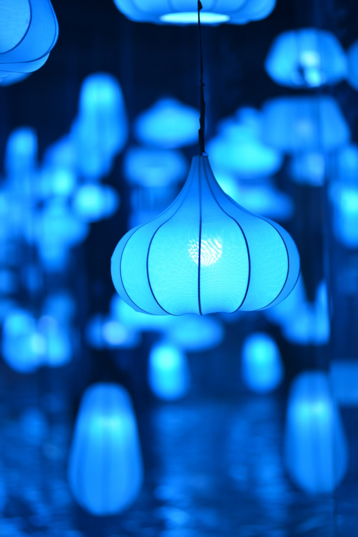 selective focus photo of blue pendant lamps