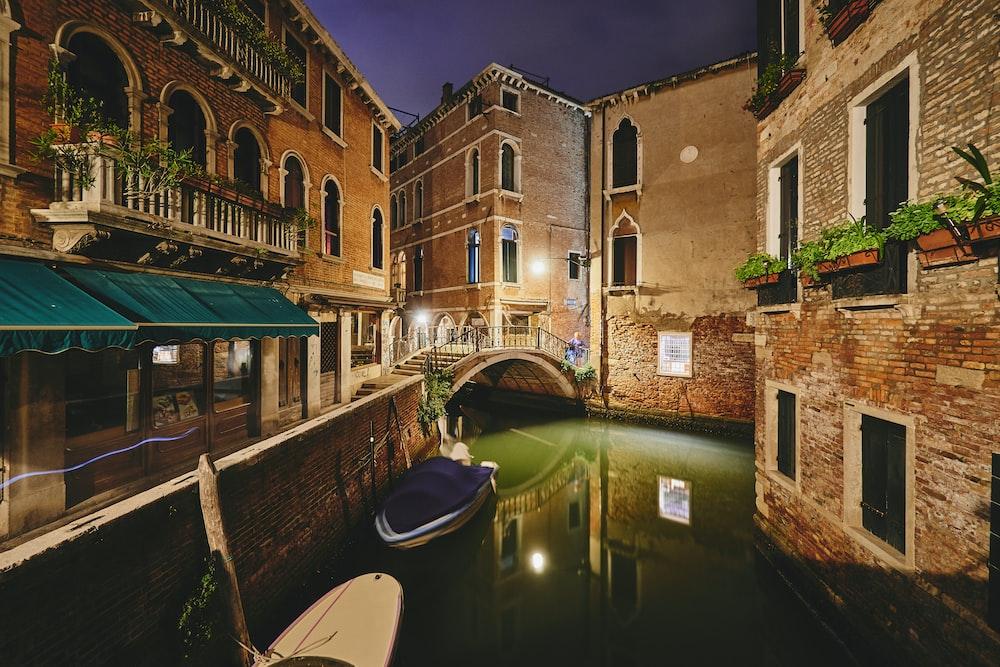 river beside buildings