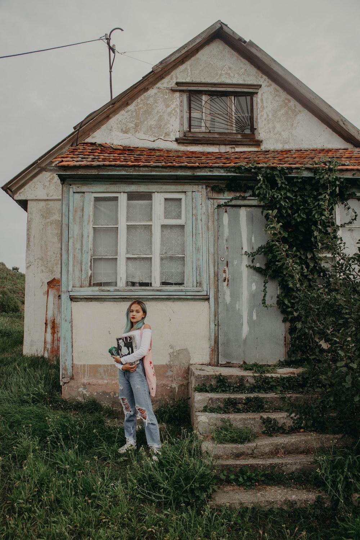 woman near gray building