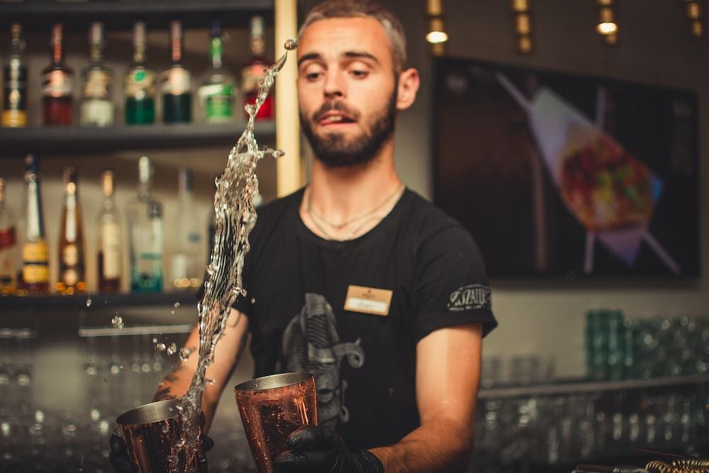 man bartering inside bar