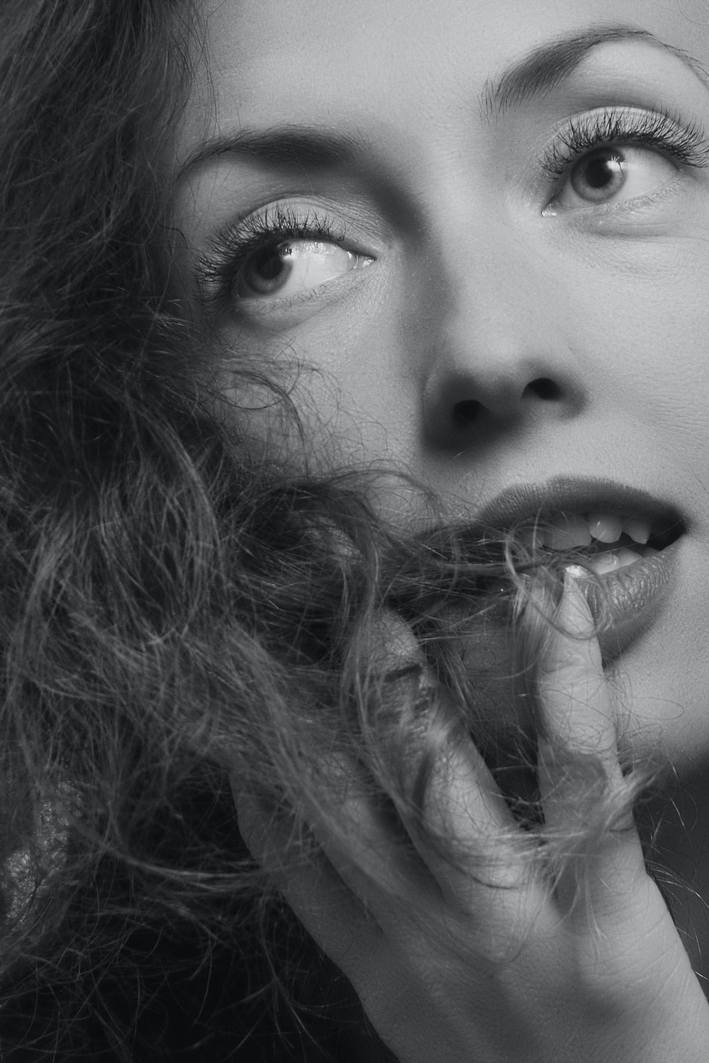 grayscale photography of woman glancing her right side