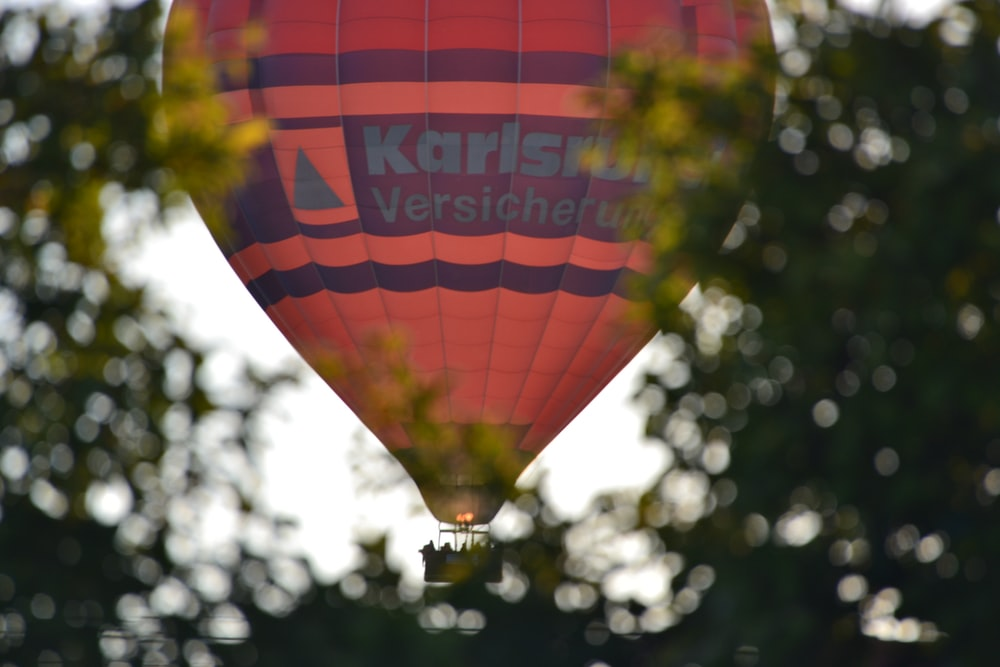 selective focus photography of pink and purple striped hot air ballooning during daytime