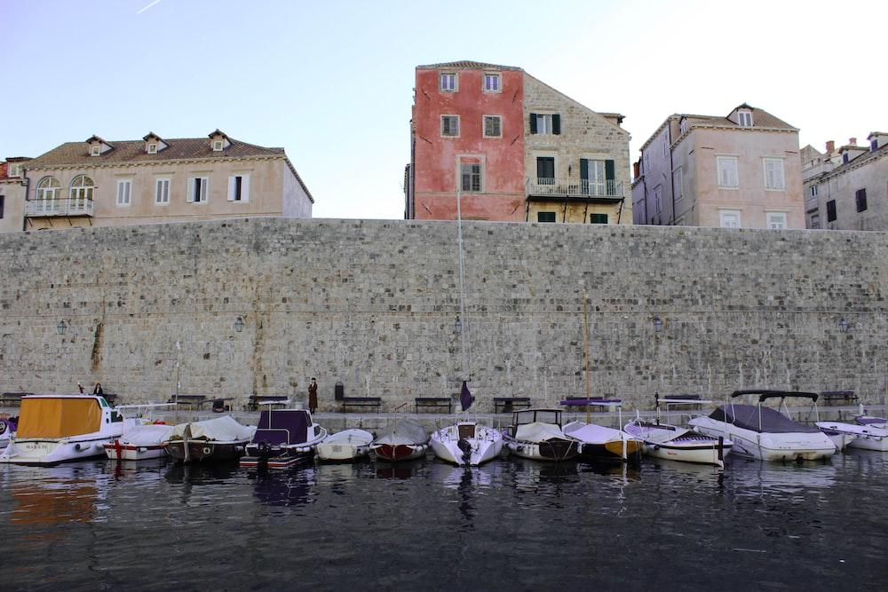 boats near concrete wall