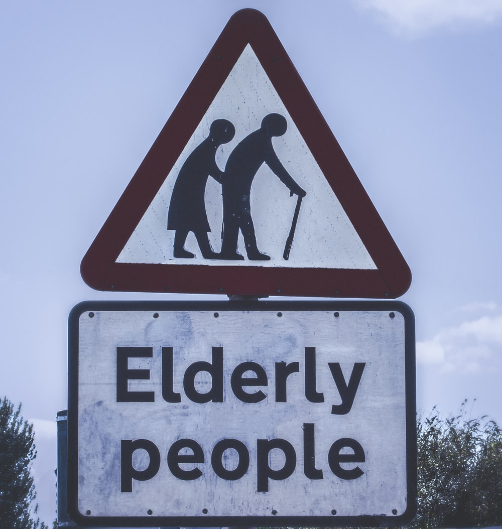 elderly people crossing road sign