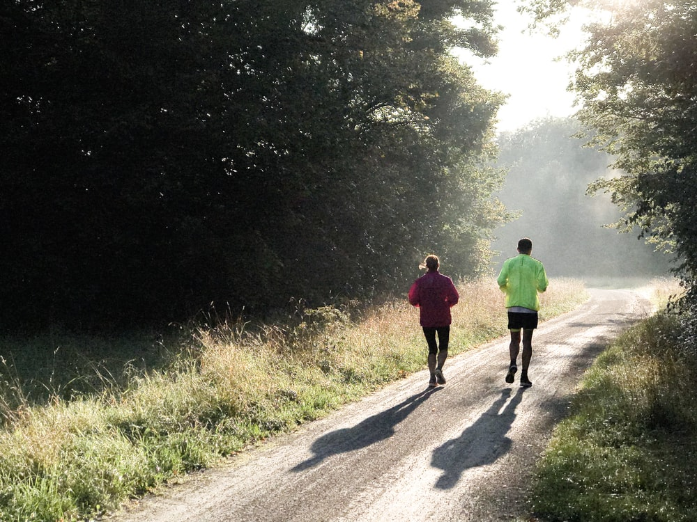 two person jogging during daytime
