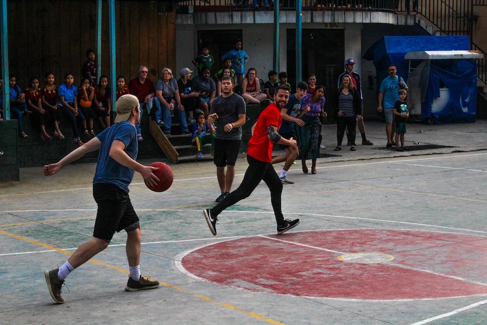 group of men playing basketball