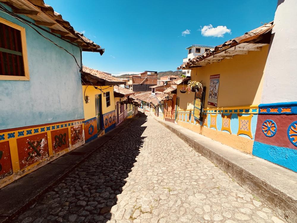 road between houses under blue sky