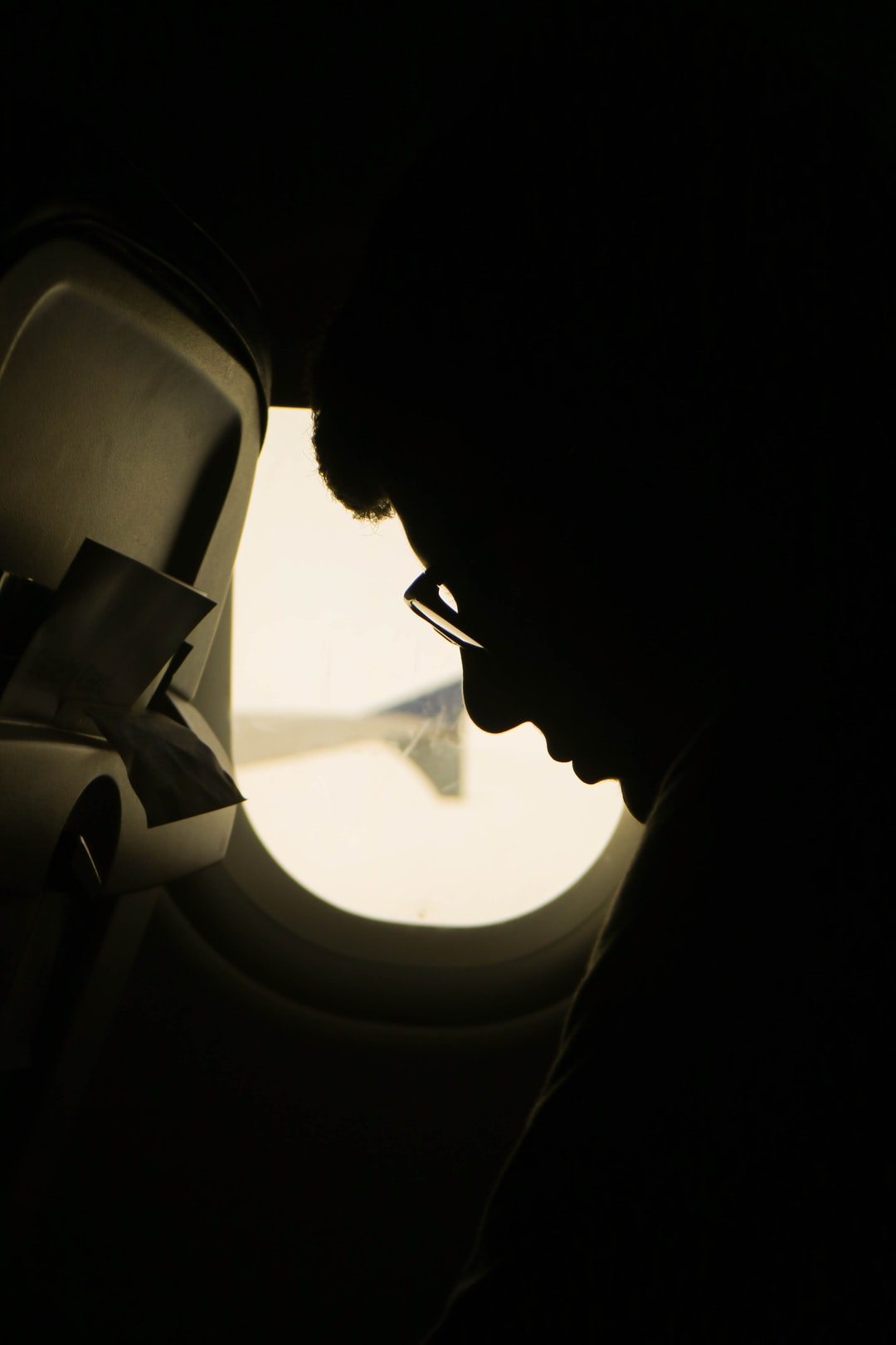 Homesick, Depressed boy thinking on an airplane (Model Credit: Adam Wright)