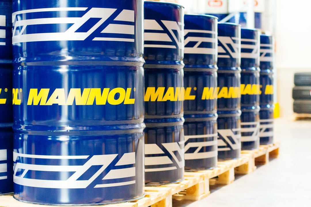 Mannol oil drums, oil barrels in warehouse for industrial editorials, marketing materials.