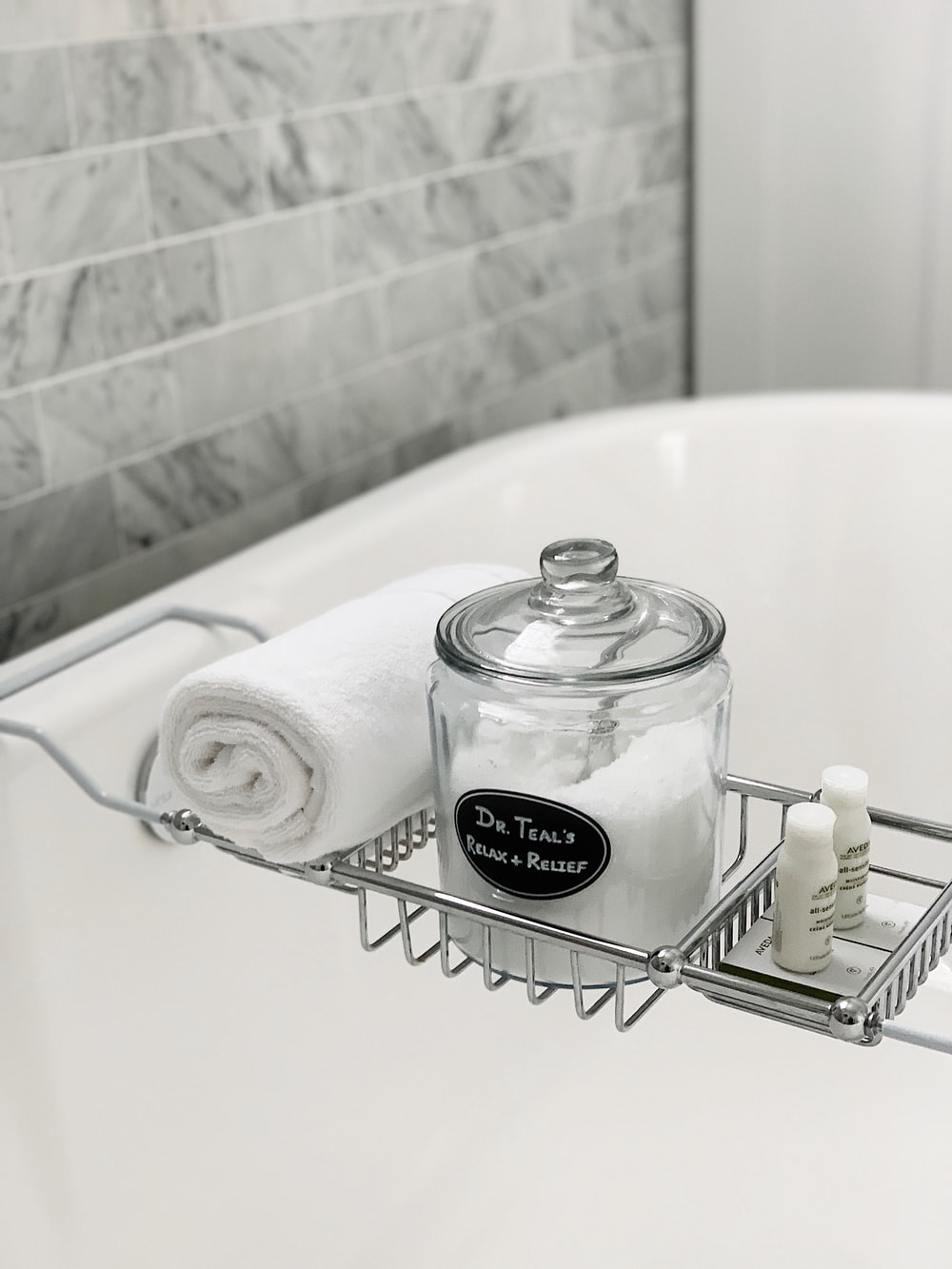 clear glass container with lid beside towel