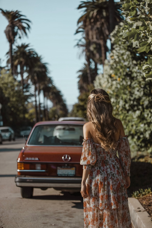 woman standing near vehicle