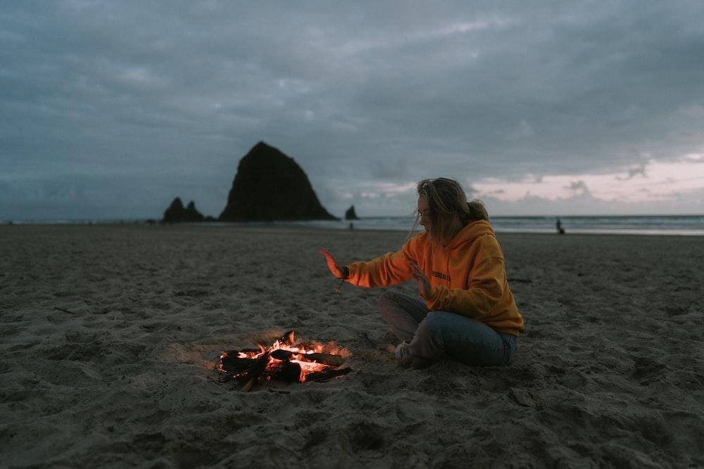 woman wearing orange pullover hoodie