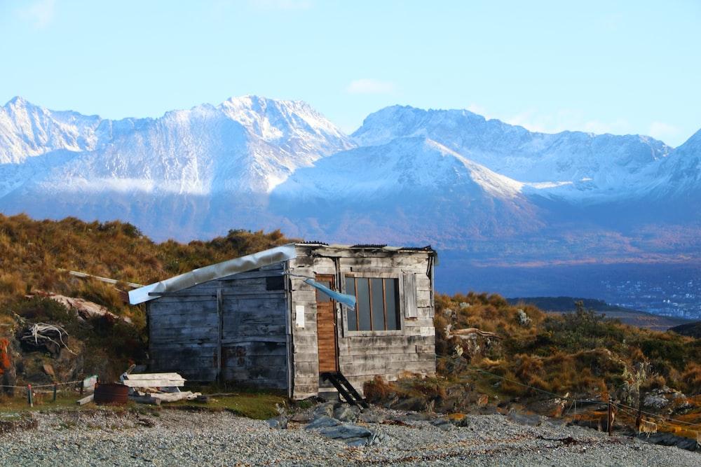 gray shed near mountian