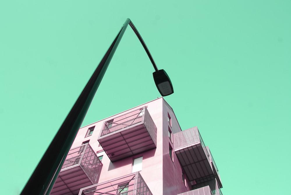 pink building besides black street lamp