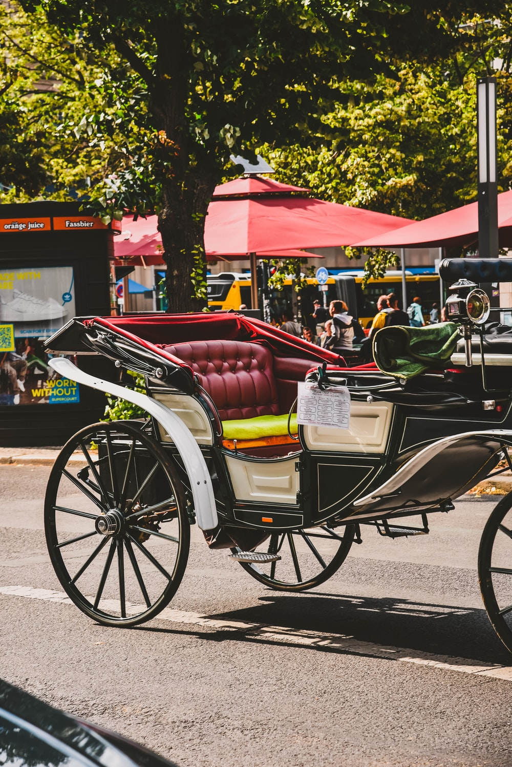black and maroon carriage on focus photography