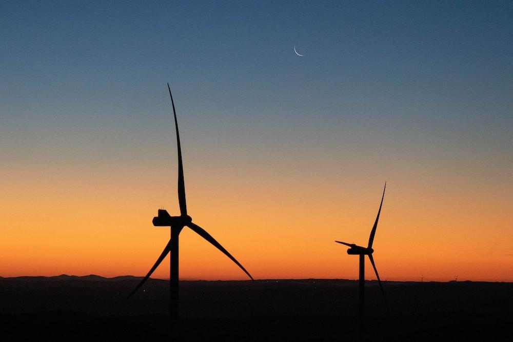 windmills during golden hour