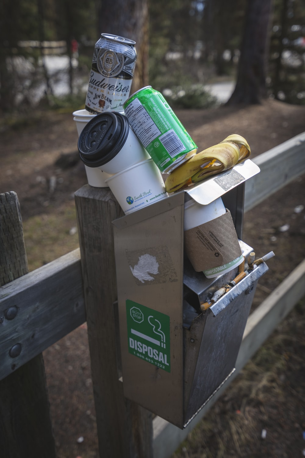 green can on brown mailbox