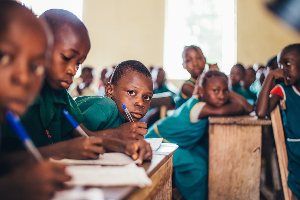 children writing in books
