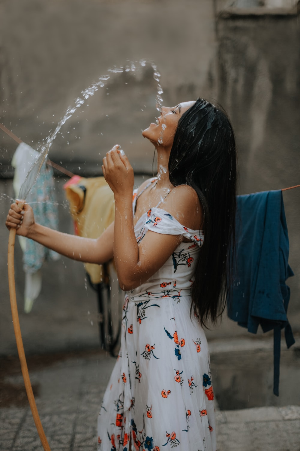 woman holding water hose