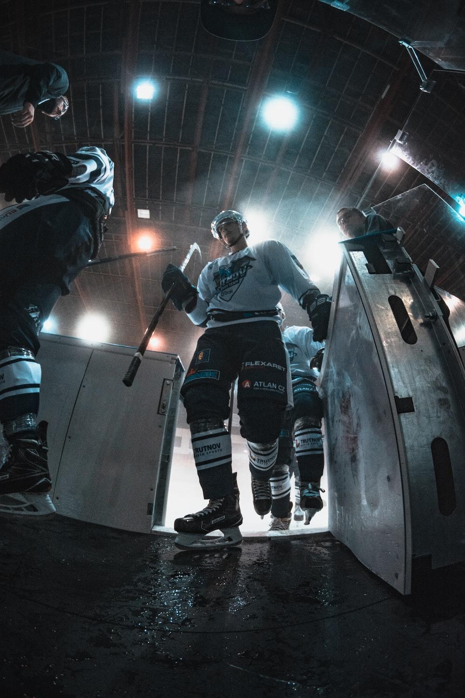 ice hockey players walking inside building