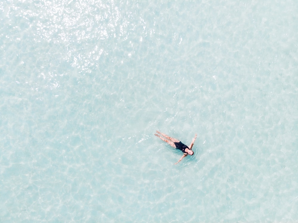 woman floating on the water surface