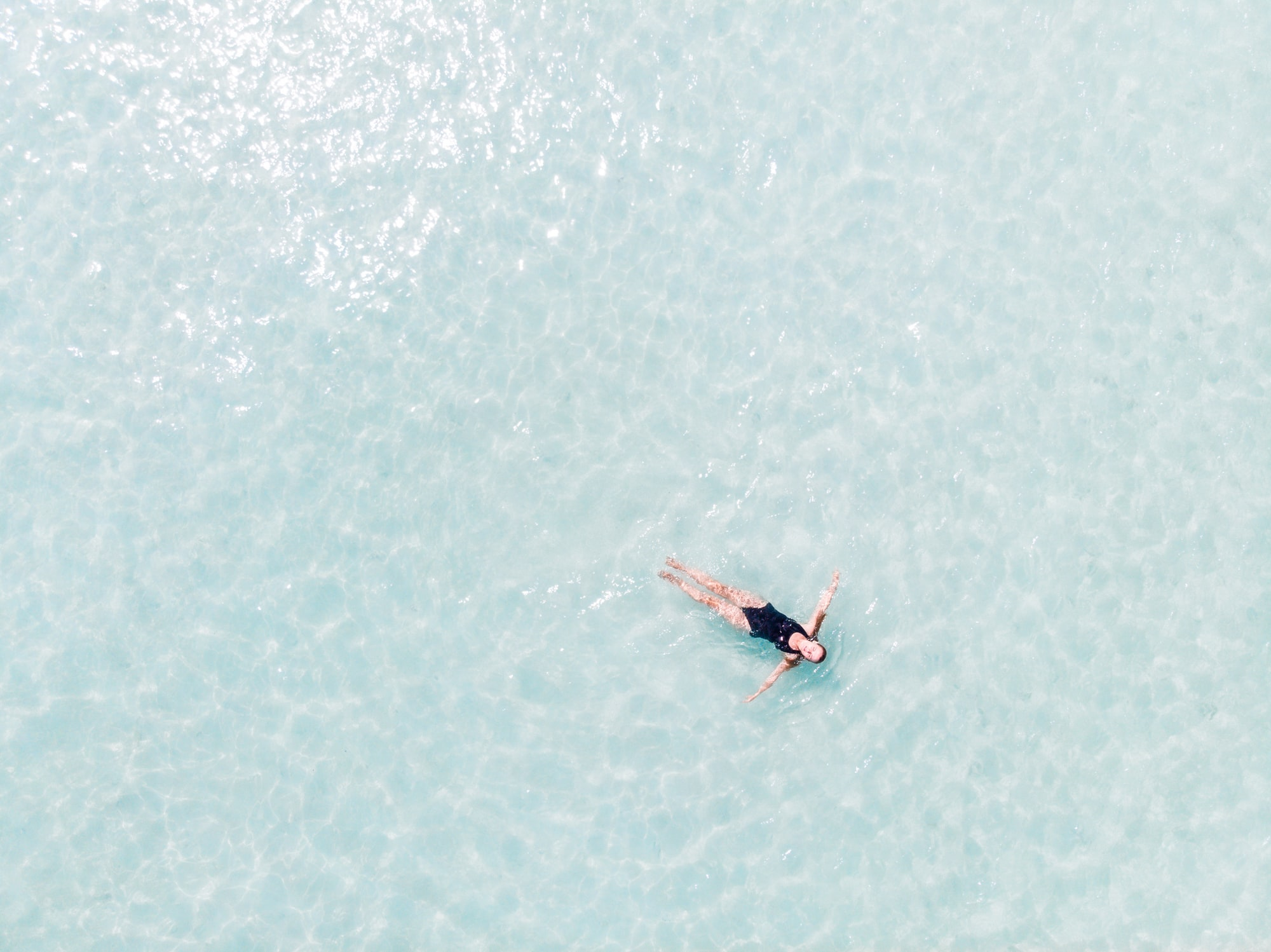 A picture of my wife in the centre of the Indian Ocean. Crystal clear and transparent water around. Pure paradise.