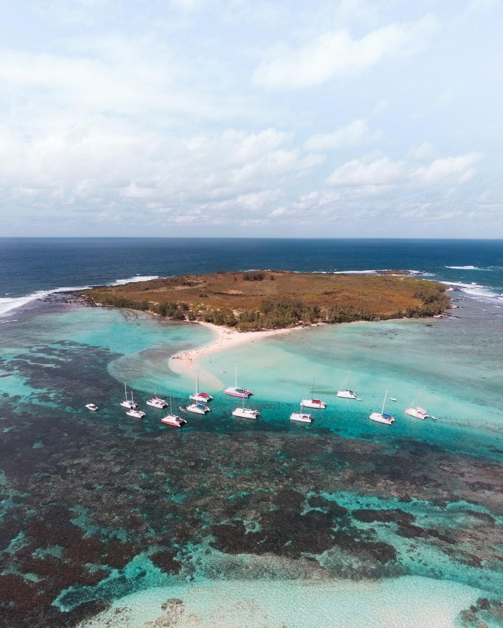 boats in sea near island