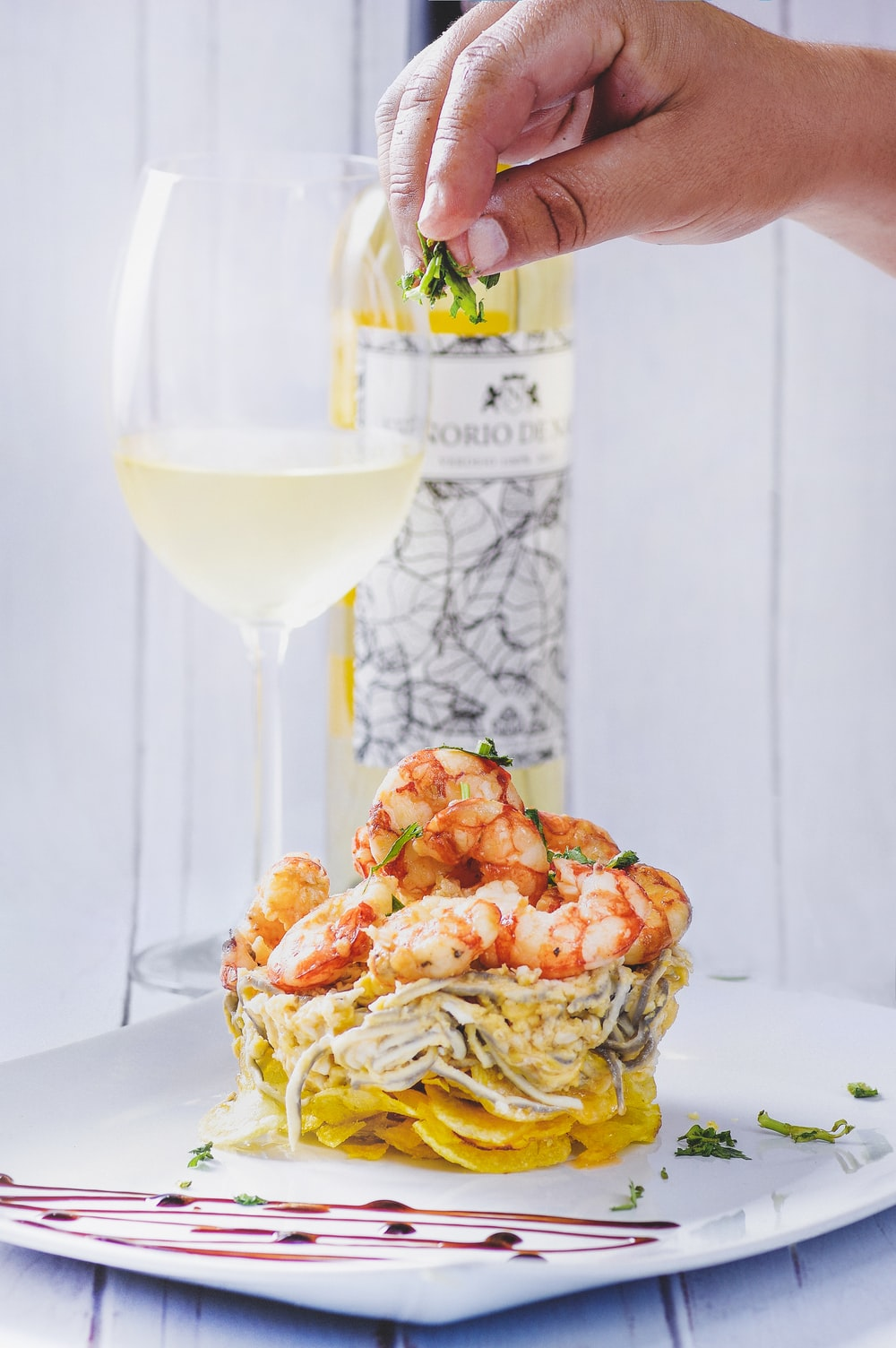 shrimp pasta and half-filled wine glass