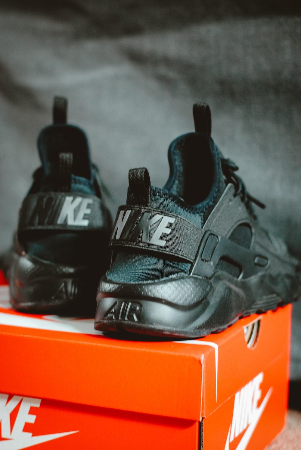 pair of triple black Nike Air Huarache sneakers photo – Free ...