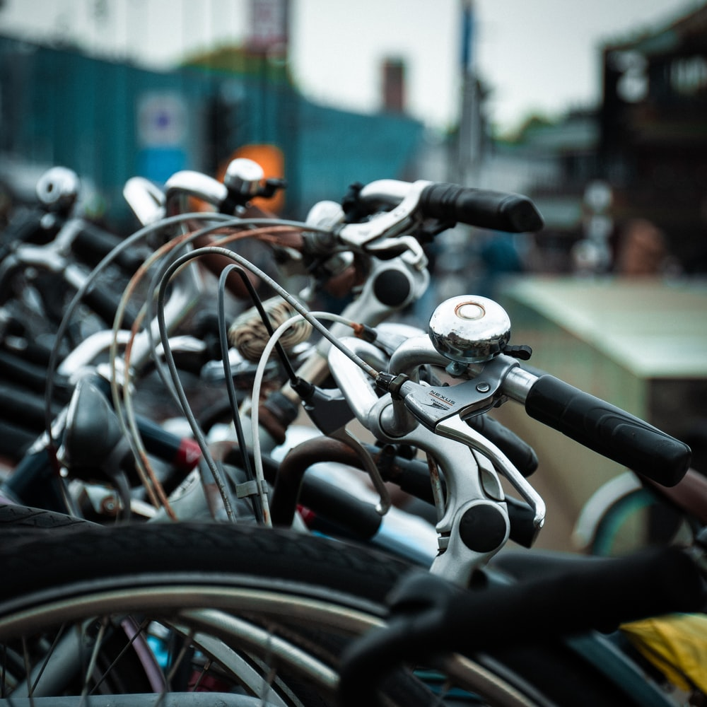 focus photography of bicycles parked near wall
