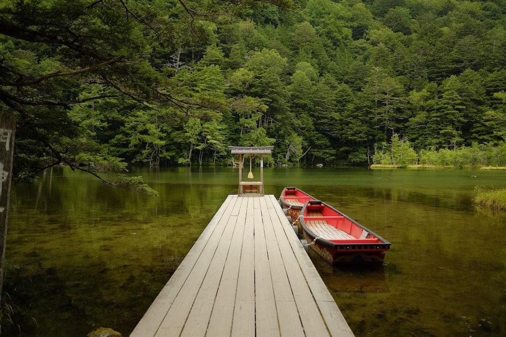 boat beside wooden dock