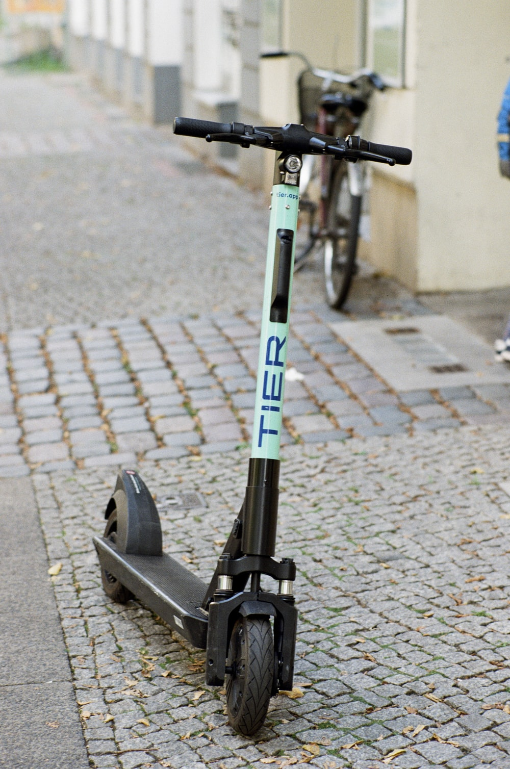 black and teal Tier kick scooter