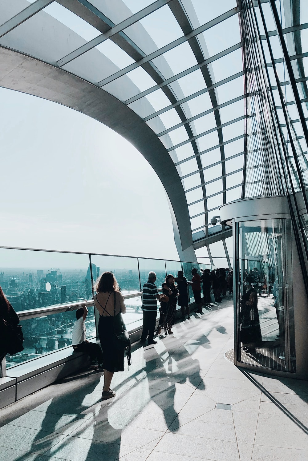 people standing near glass frame