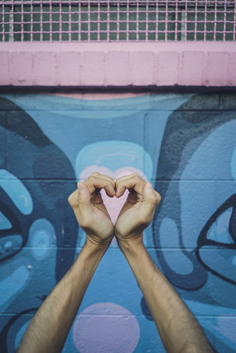 human hands doing heart gesture