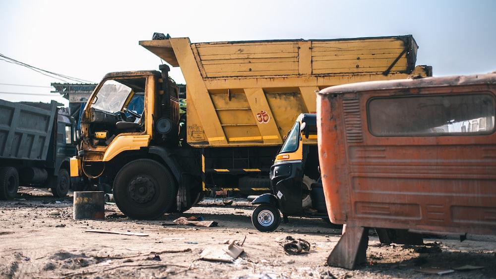 yellow dump truck during daytime