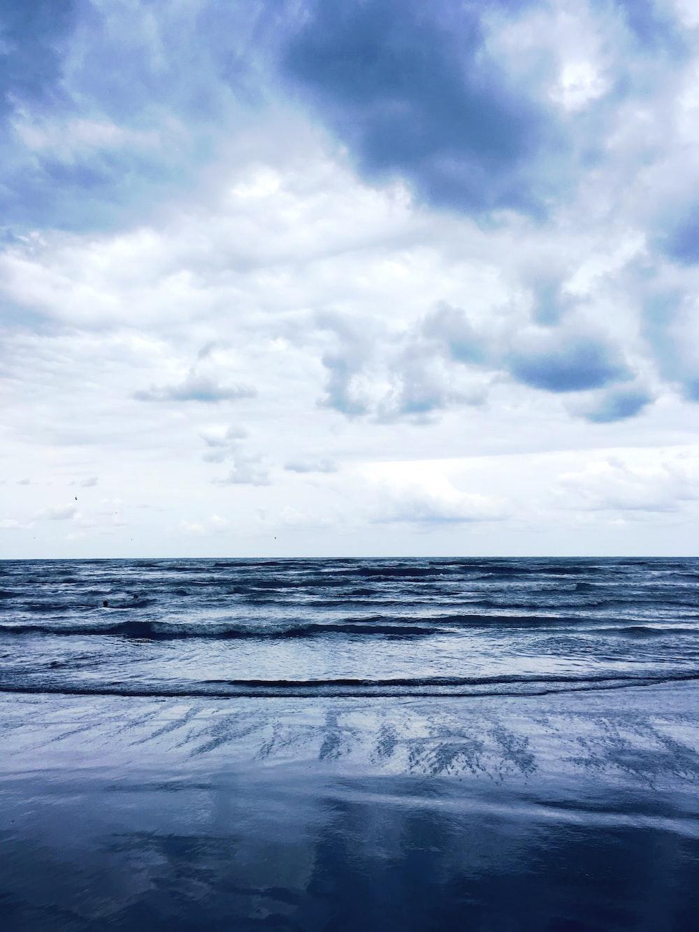 sea under clouded sky