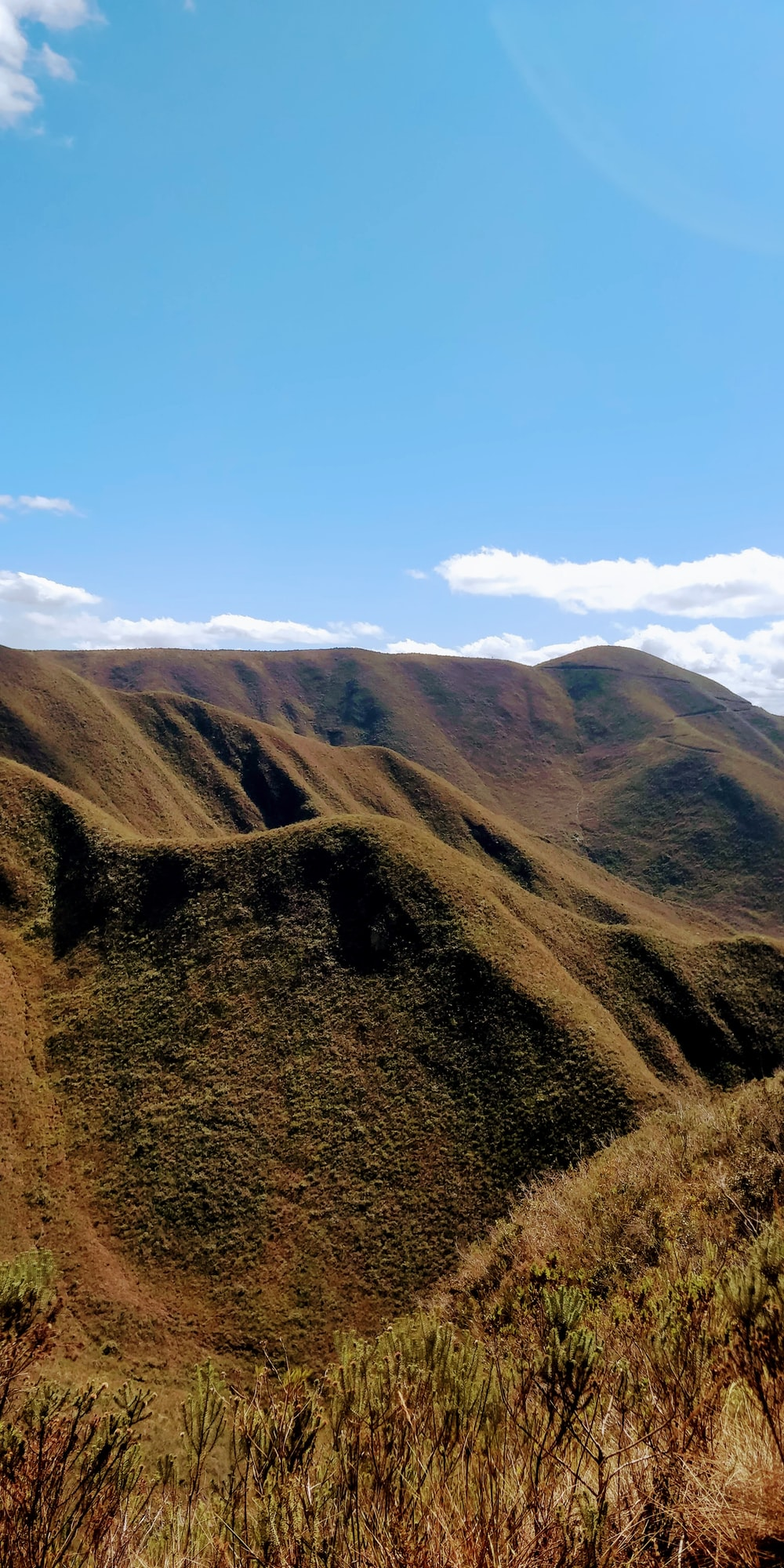 green mountain under blue sky \