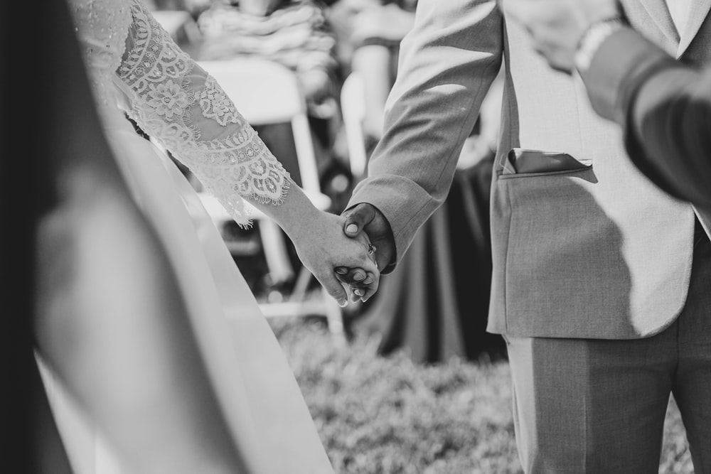 wedding couple hold each other's hand