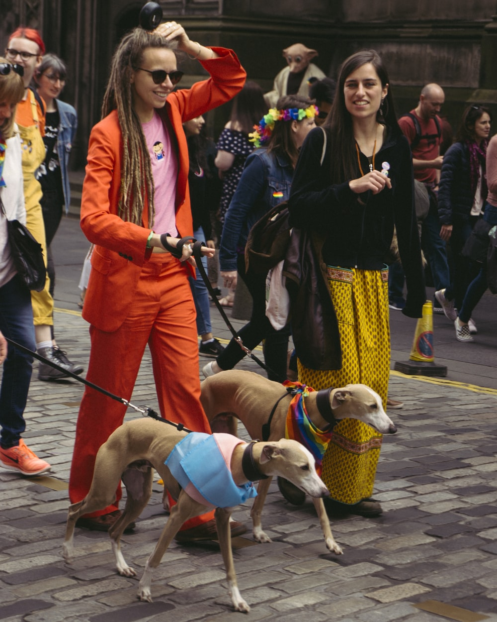 woman wearing red blazer while holding dog