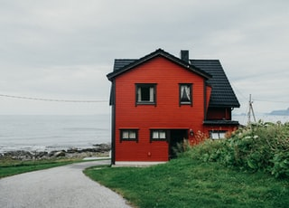 red and black house near bushes