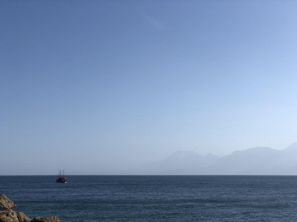 boat in ocean during daytime