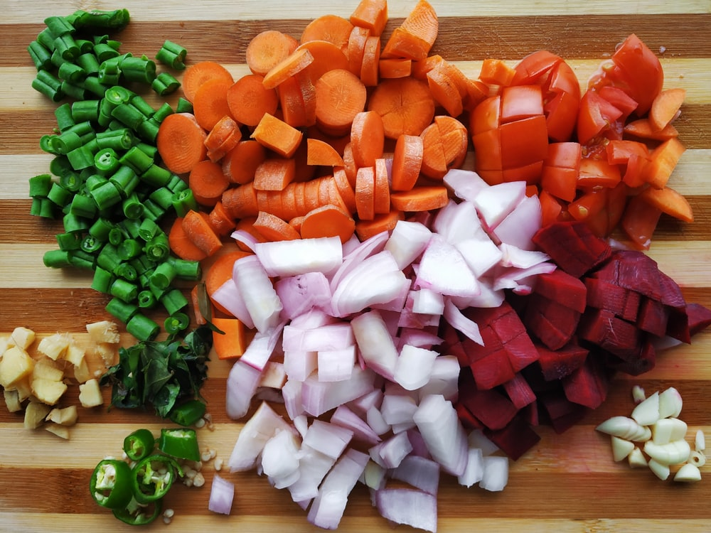 slice of vegetables on brown chopping board